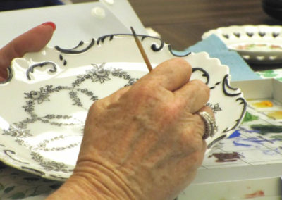 hand painting a dish