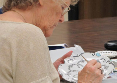 lady painting a dish